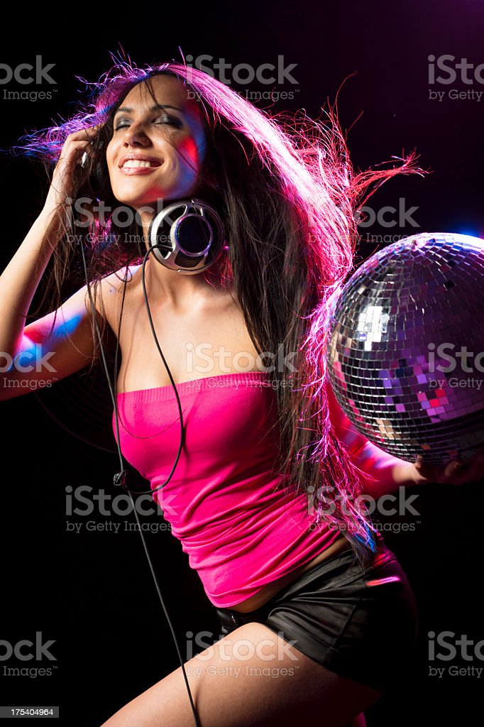 Women listening music and dancing with disco ball royalty-free stock photo