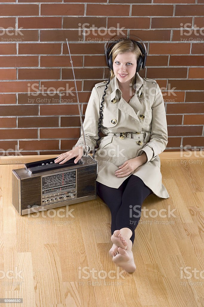 women listens to an old radio royalty-free stock photo