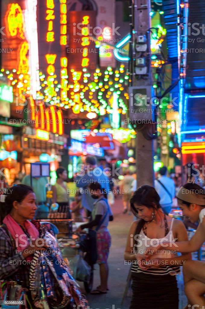 Women Look A Street Vendors Goods In Soi Cowboy, Bangkok stock photo