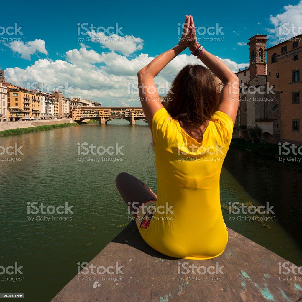 women look at Ponte vecchio florenz stock photo