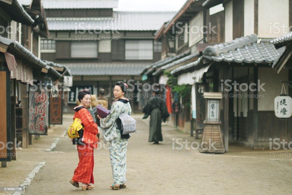Women look back in Edo Period street stock photo
