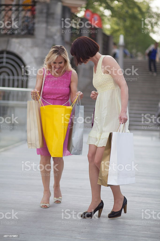 Women looking into shopping bag stock photo