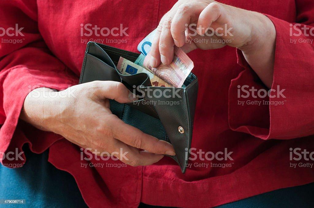 Women looks in her wallet stock photo