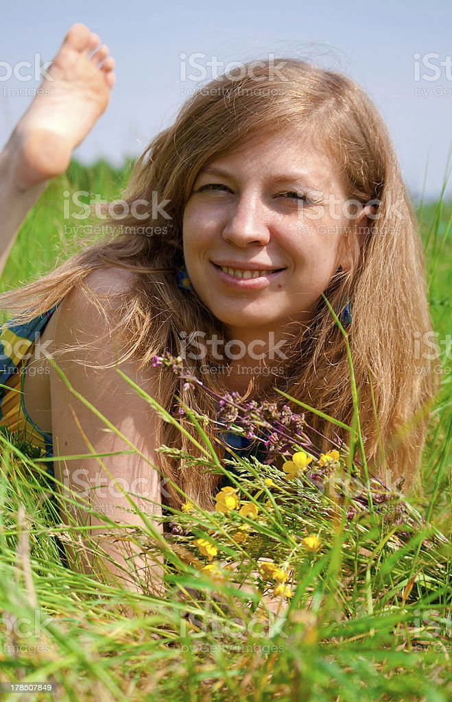 Women lying in meadow royalty-free stock photo