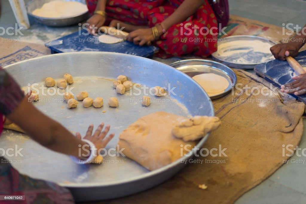Women making Indian flat bread stock photo