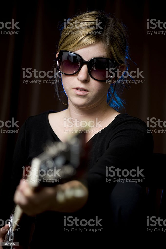Women musician with a Guitar stock photo