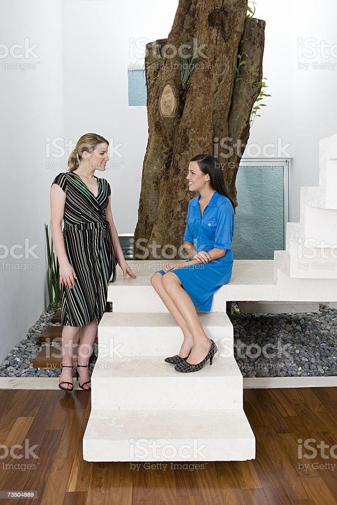 Women near a tree in office royalty-free stock photo