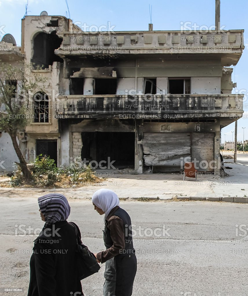 Women near the destroyed house stock photo