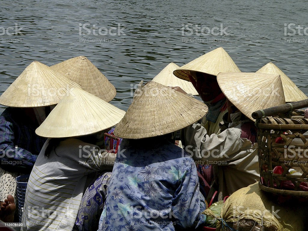 Women on a crowded local ferry in Hoi An, Vietnam stock photo