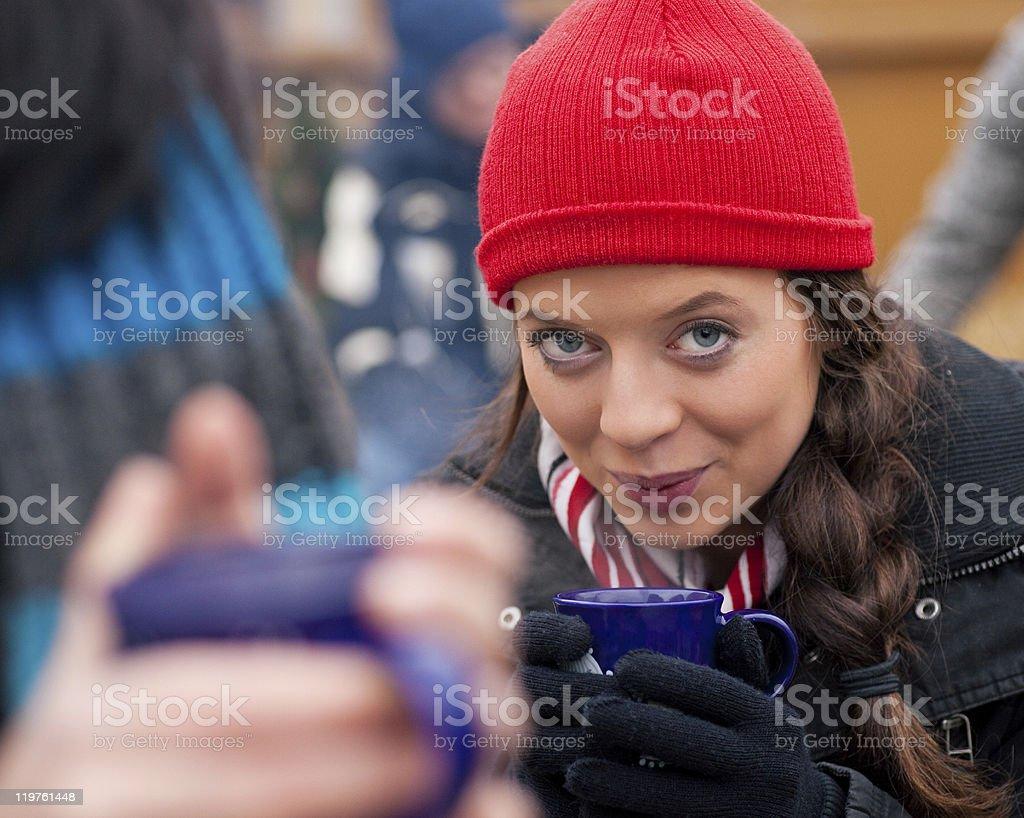 Women on Christmas market drinking punch stock photo