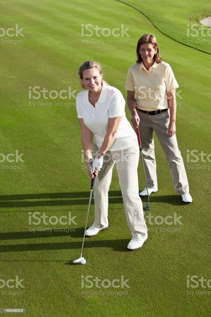 Women on golf course royalty-free stock photo