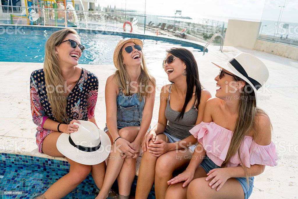 Women on holidays relaxing at the pool stock photo