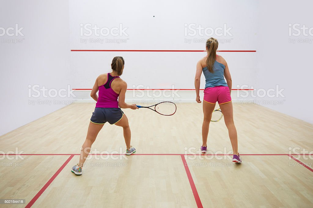 Women on the move at the squash court stock photo