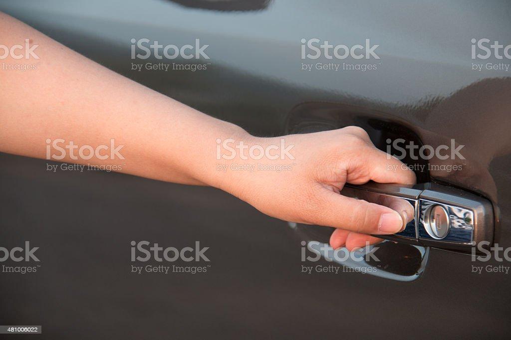 Women open car door stock photo
