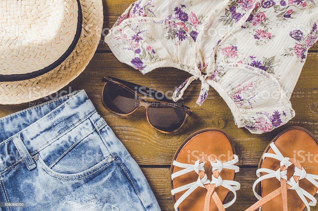 Women outfit on wooden table stock photo