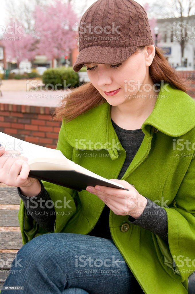 Women outside reading a book stock photo