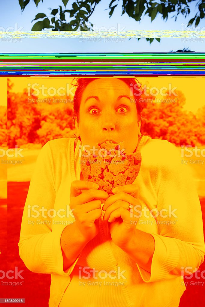 Women Outside with Large Cookie stock photo