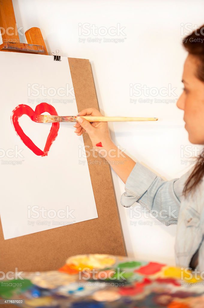 women painter is painting love stock photo
