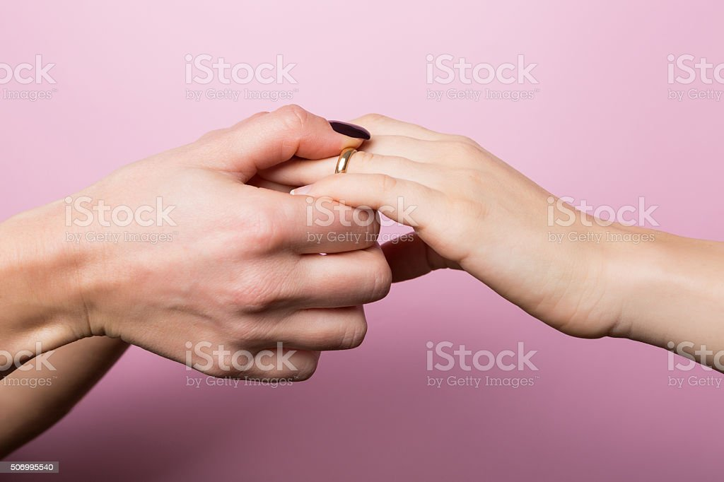 Women Partners Exchanging Rings in Engagement for St. Valentine stock photo