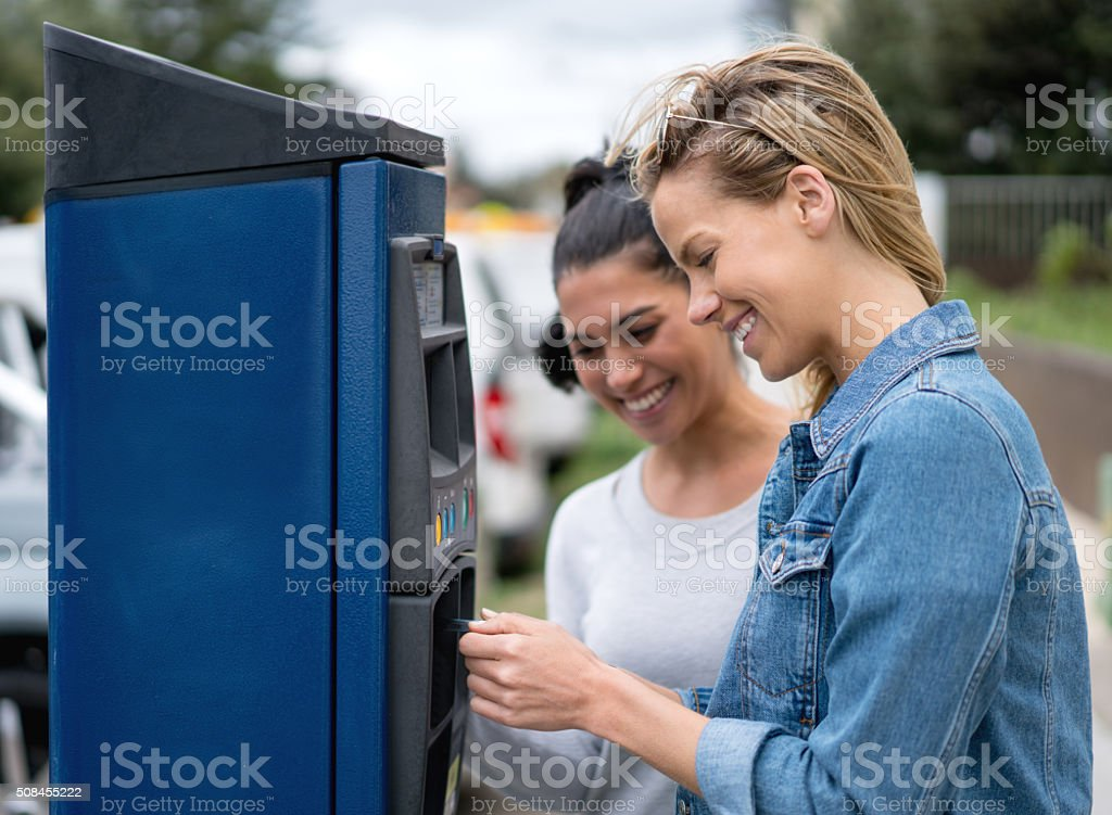 Women paying for parking stock photo