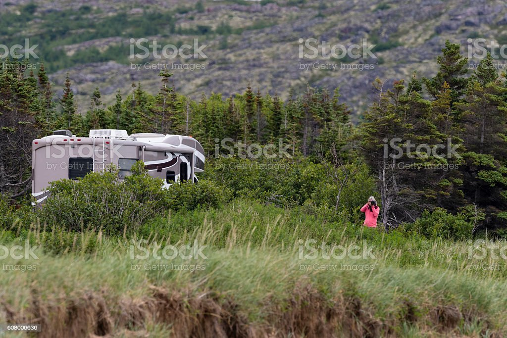 Women photographing in road trip, Motorhome in Labrador, camping stock photo