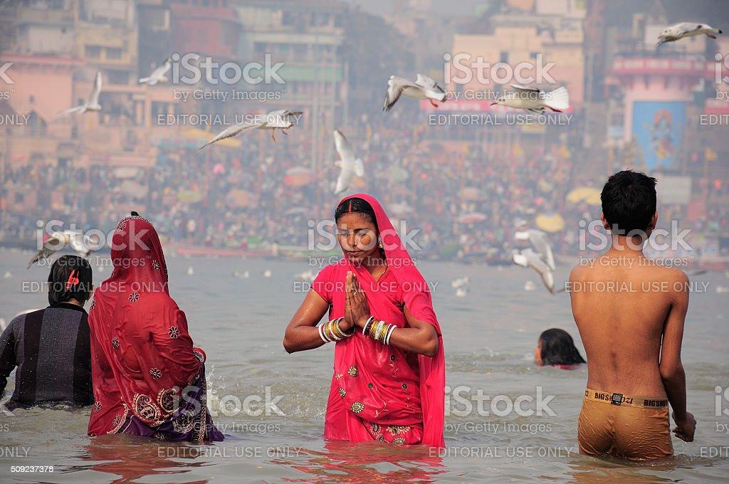 Women pilgrims bathing in the Ganges river stock photo