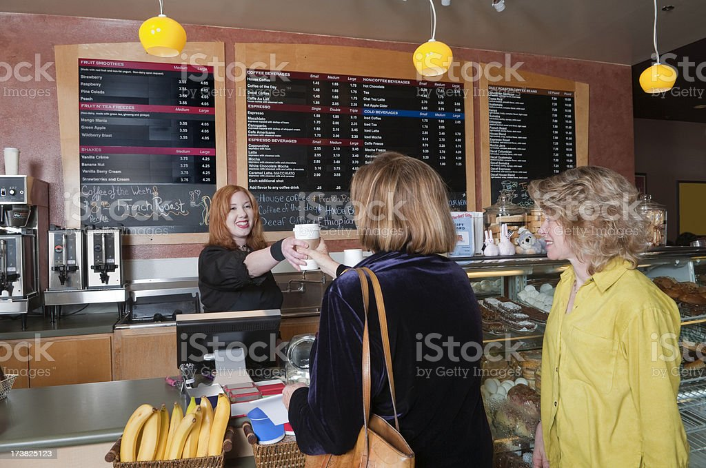 Women Placing Order in Coffee Shop royalty-free stock photo