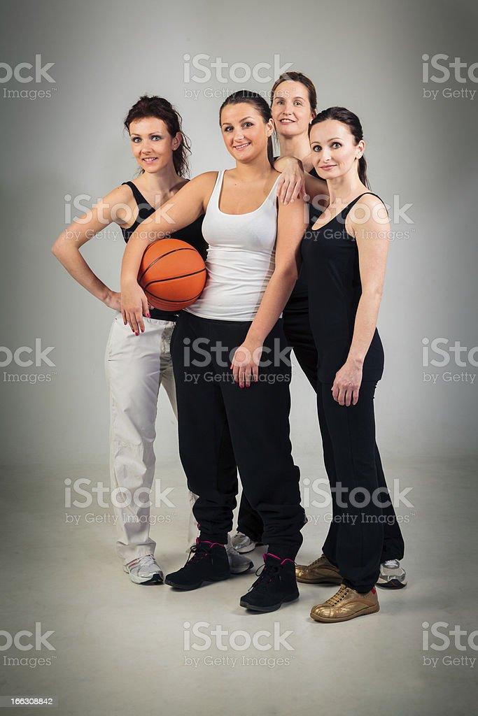 4 women playing basketball stock photo