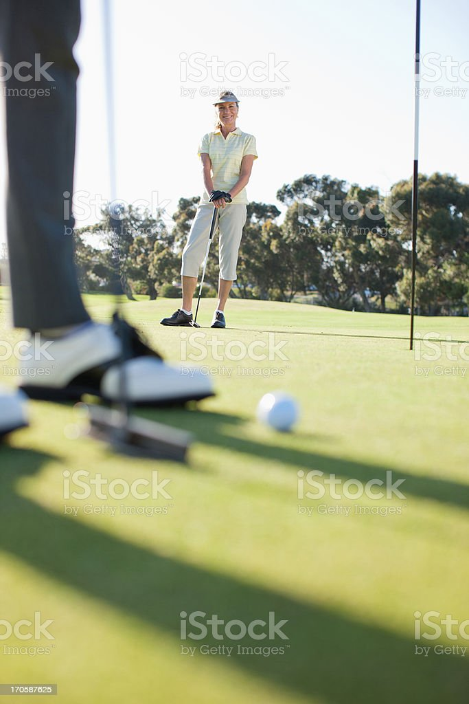 Women playing golf royalty-free stock photo