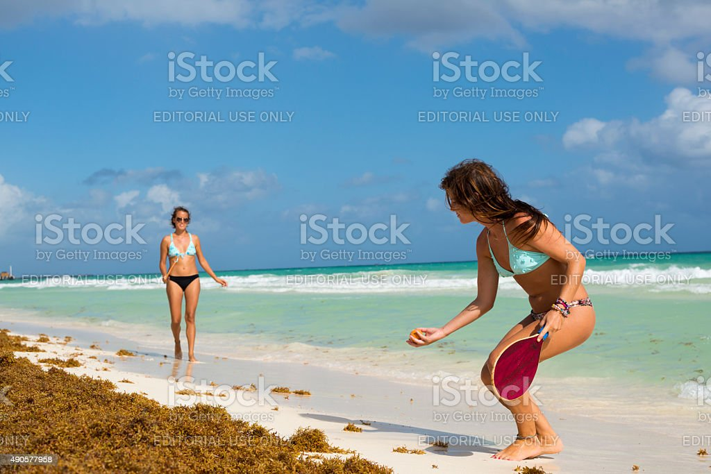 Women playing paddle ball in Playa del Carmen stock photo