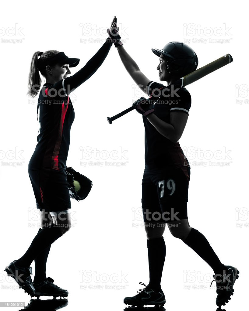 women playing softball players silhouette isolated stock photo