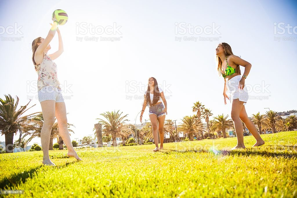 Women playing volley at park stock photo