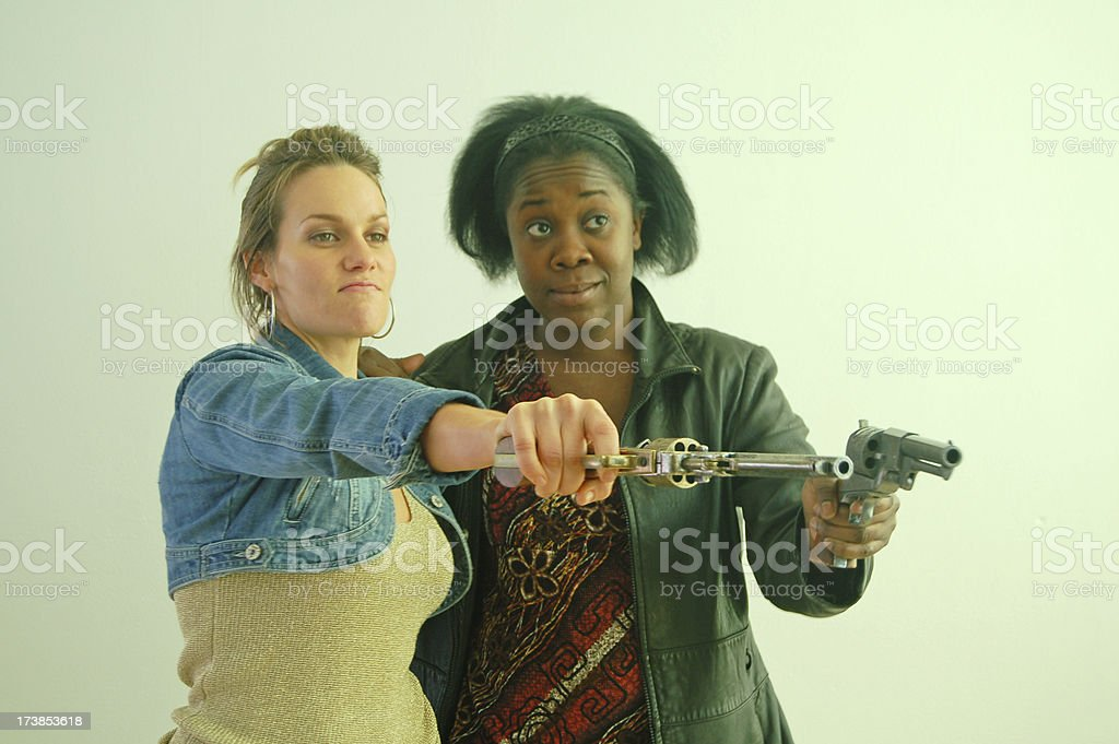 Women Pointing Guns stock photo
