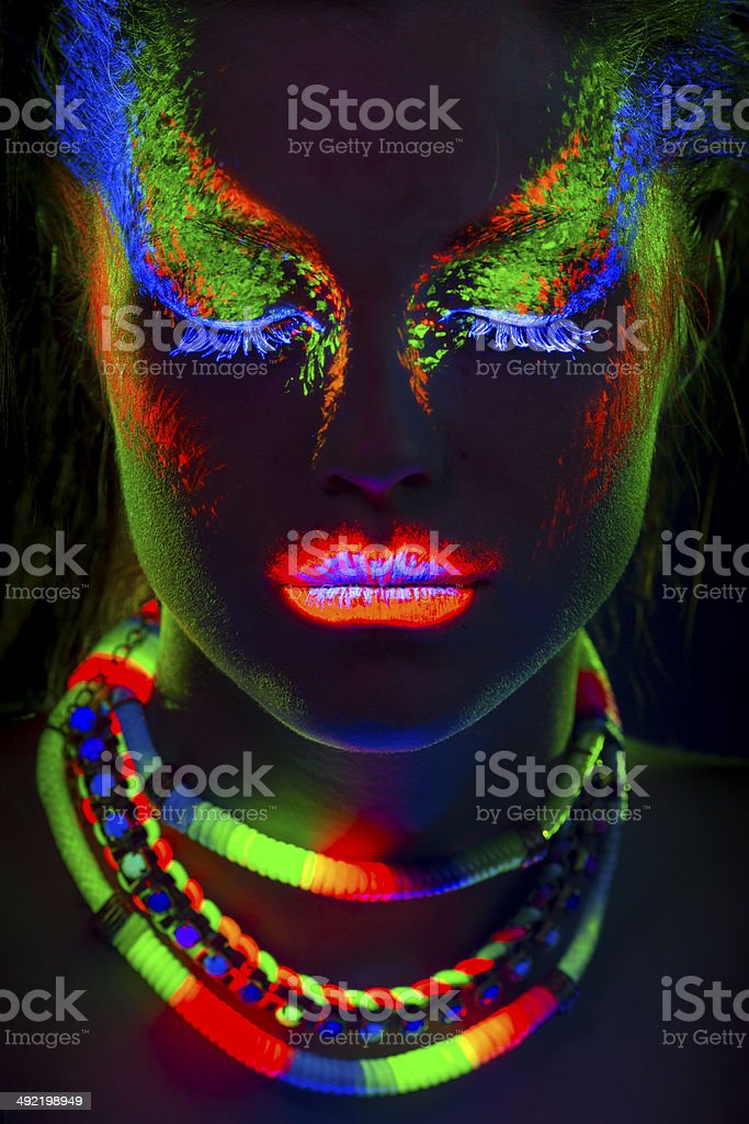 Women Portrait in Ultraviolet Light stock photo