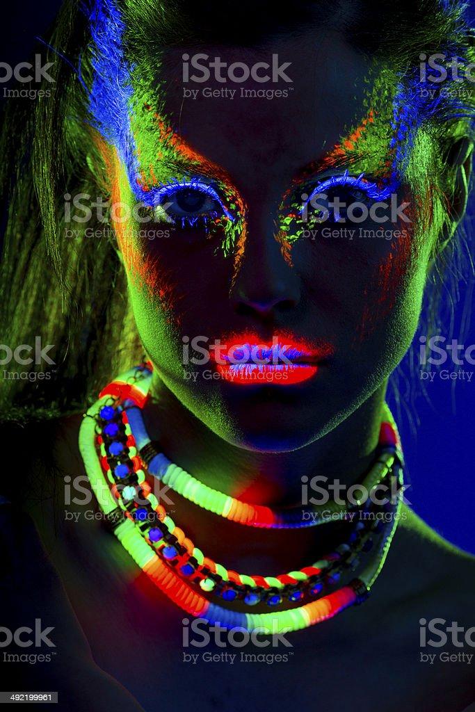 Women Portrait in Ultraviolet Light royalty-free stock photo