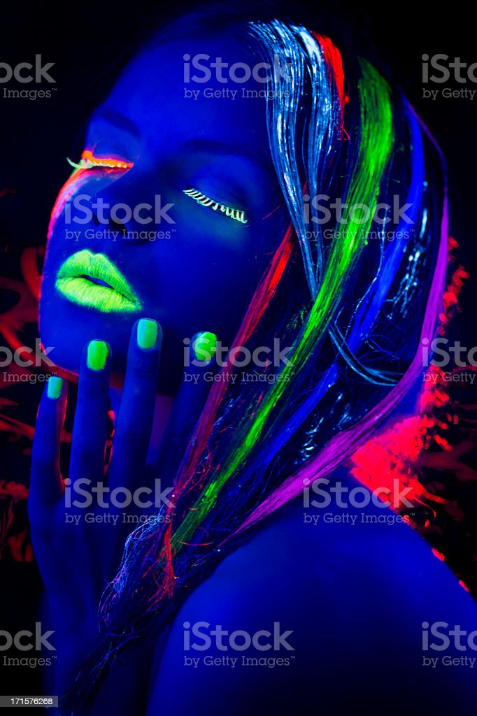 Women Portrait with Glowing Multi Colored Hair in black light stock photo