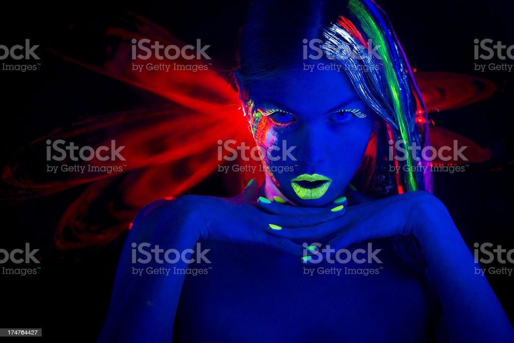 Women Portrait with Glowing Multi Colored makeup in Neon Light royalty-free stock photo