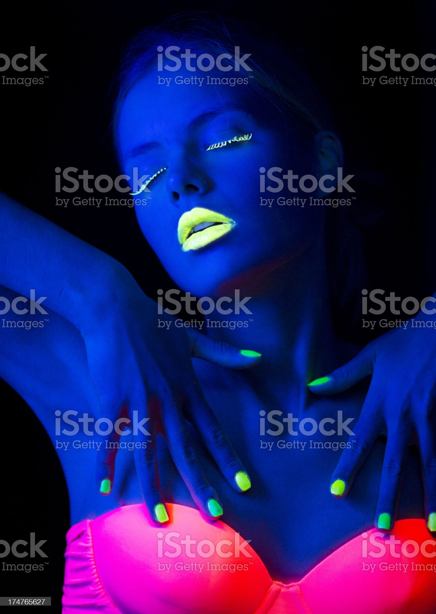 Women Portrait with Lime Green Fingernails in Neon Light royalty-free stock photo