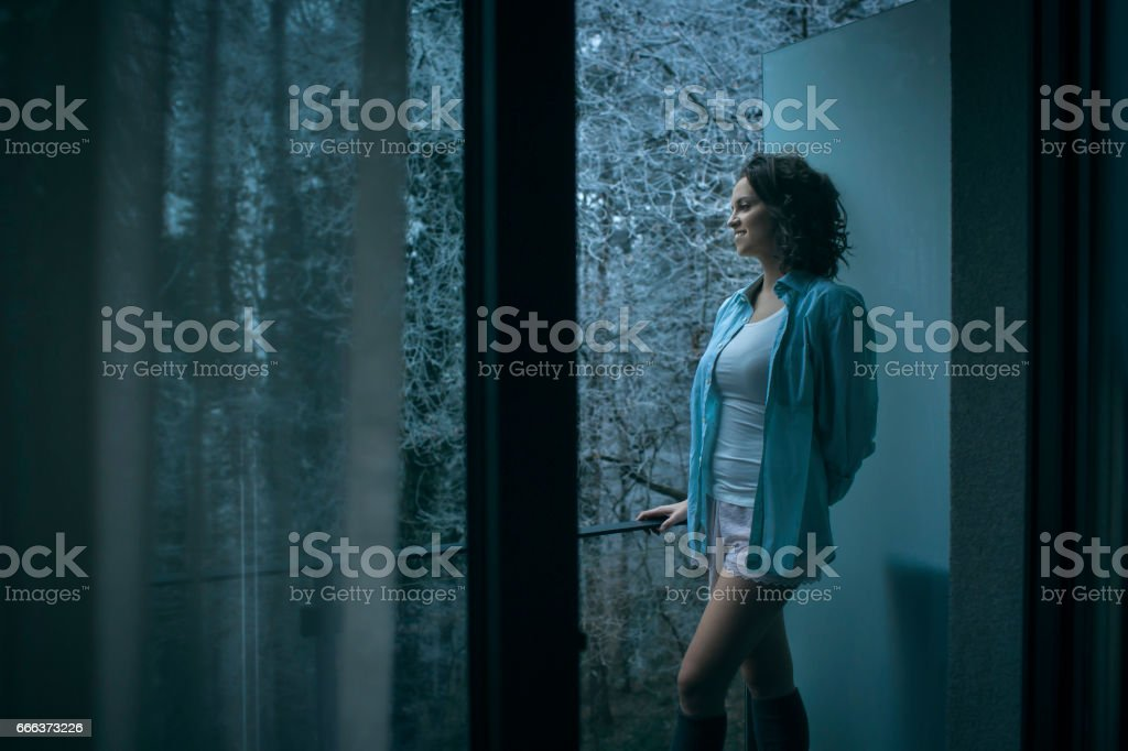 Women posing on balcony although it's winter outside stock photo
