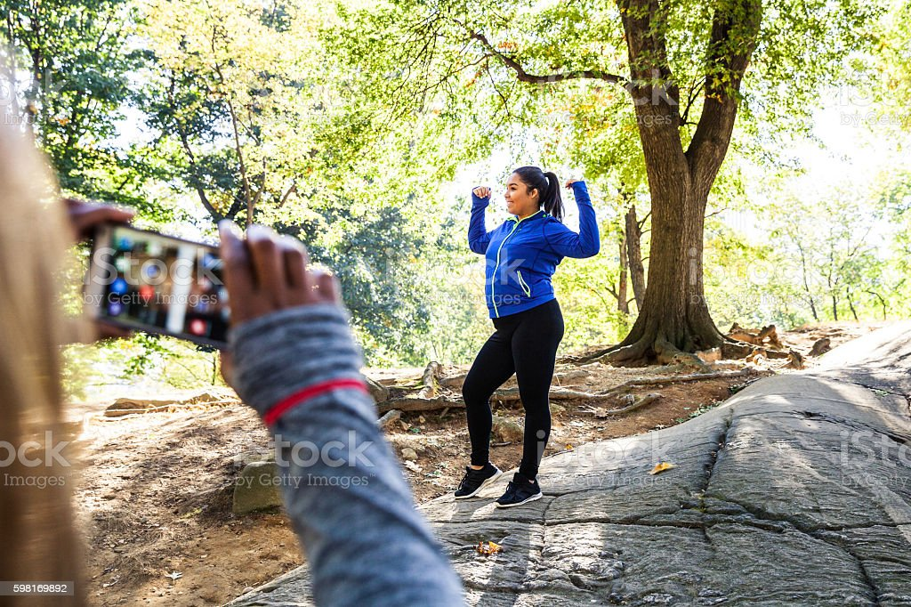 Women posing post workout in Central Park New York stock photo