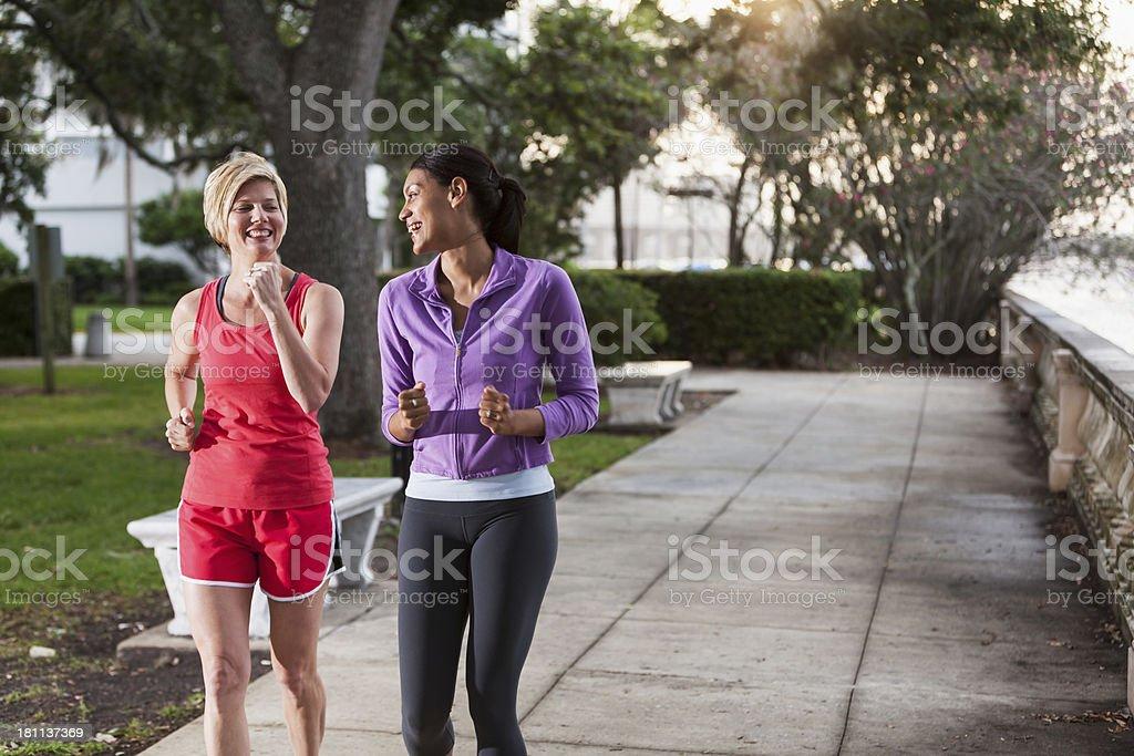 Women power walking in park royalty-free stock photo
