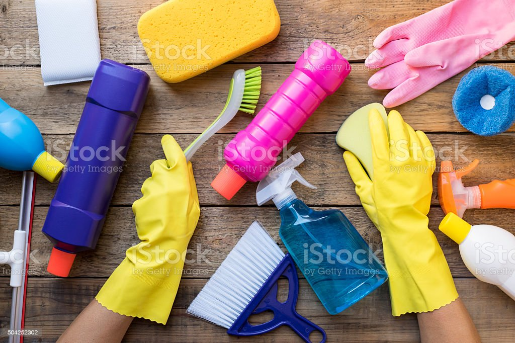 Women prepare to clean house on wood table stock photo