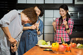 Women preparing for dinner at home.