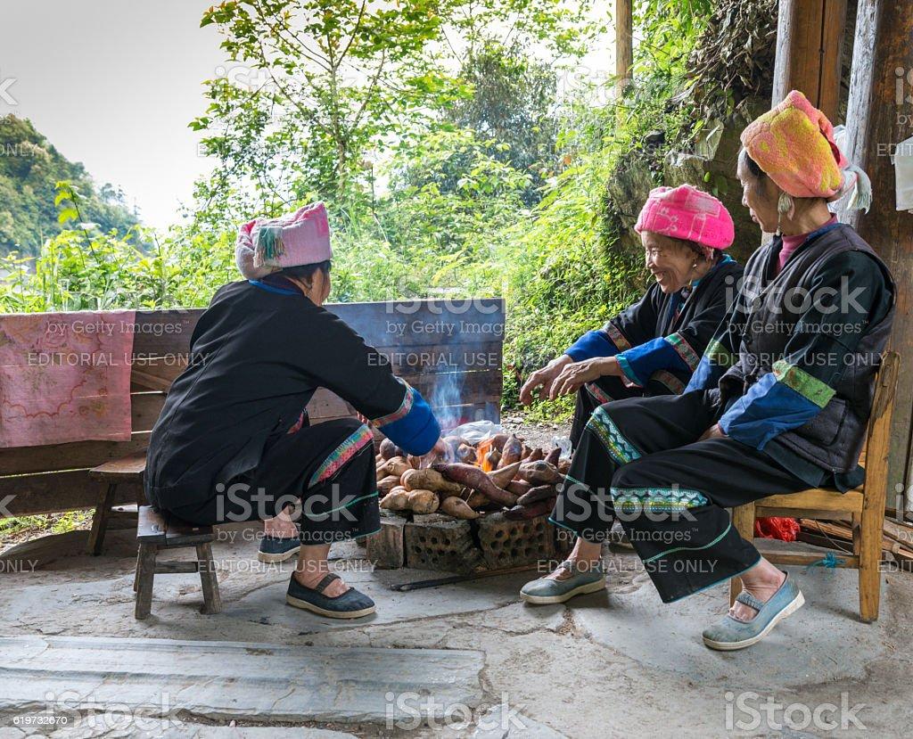 women  preparing sweet potatoes  for long table feast, China. stock photo