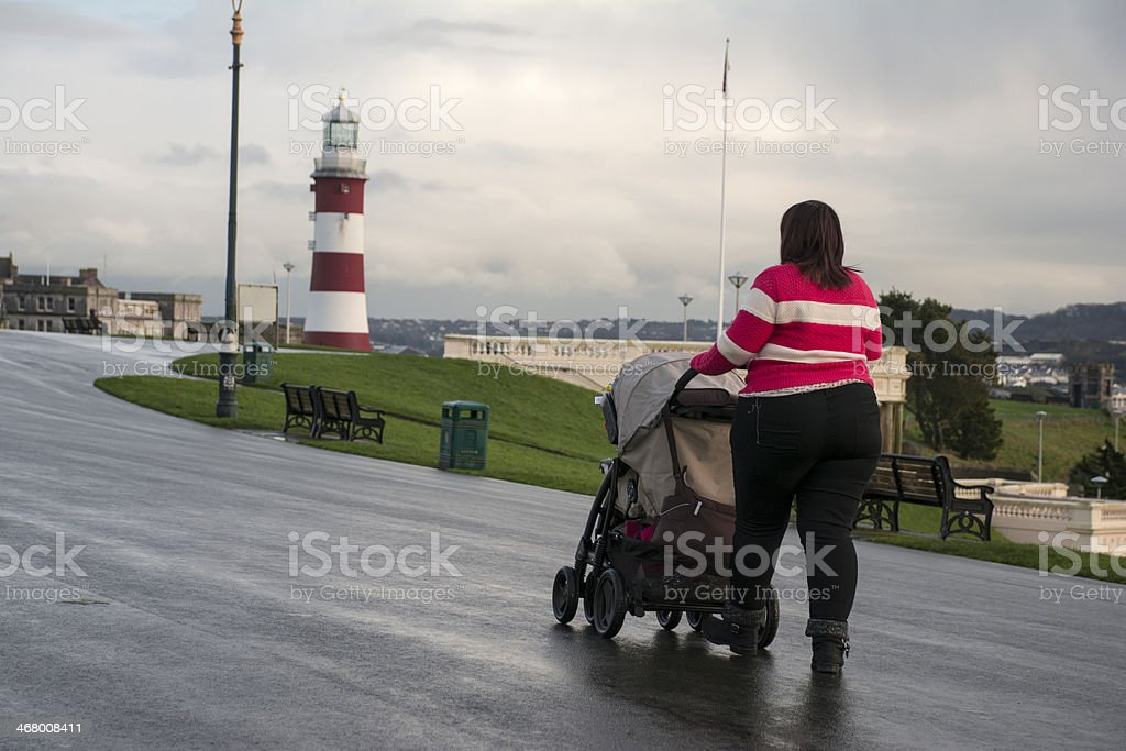 Women pushing pram on Plymouth Hoe royalty-free stock photo