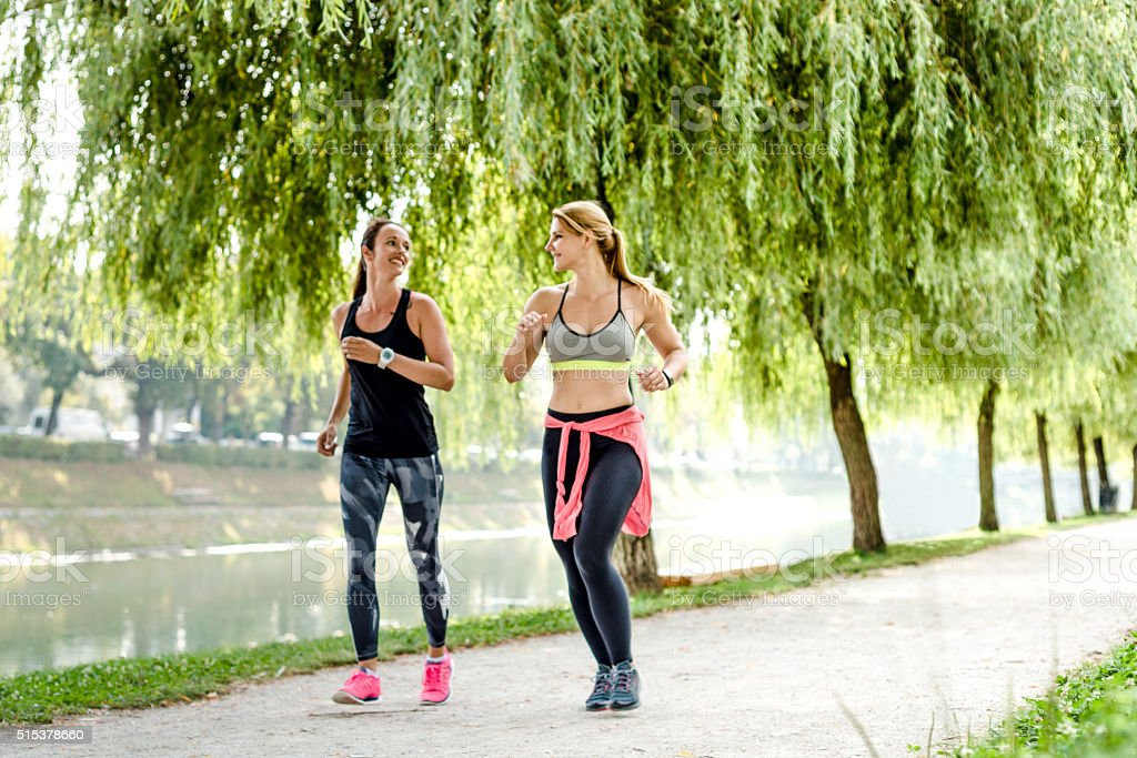 Women quickly walking in park stock photo