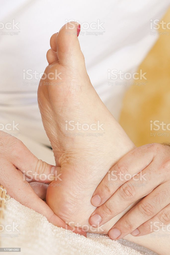 women receiving a foot massage at the spa royalty-free stock photo