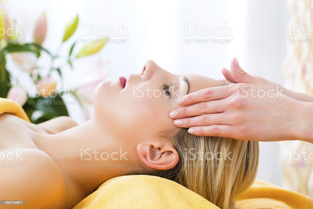 A women receiving a head massage in a spa stock photo