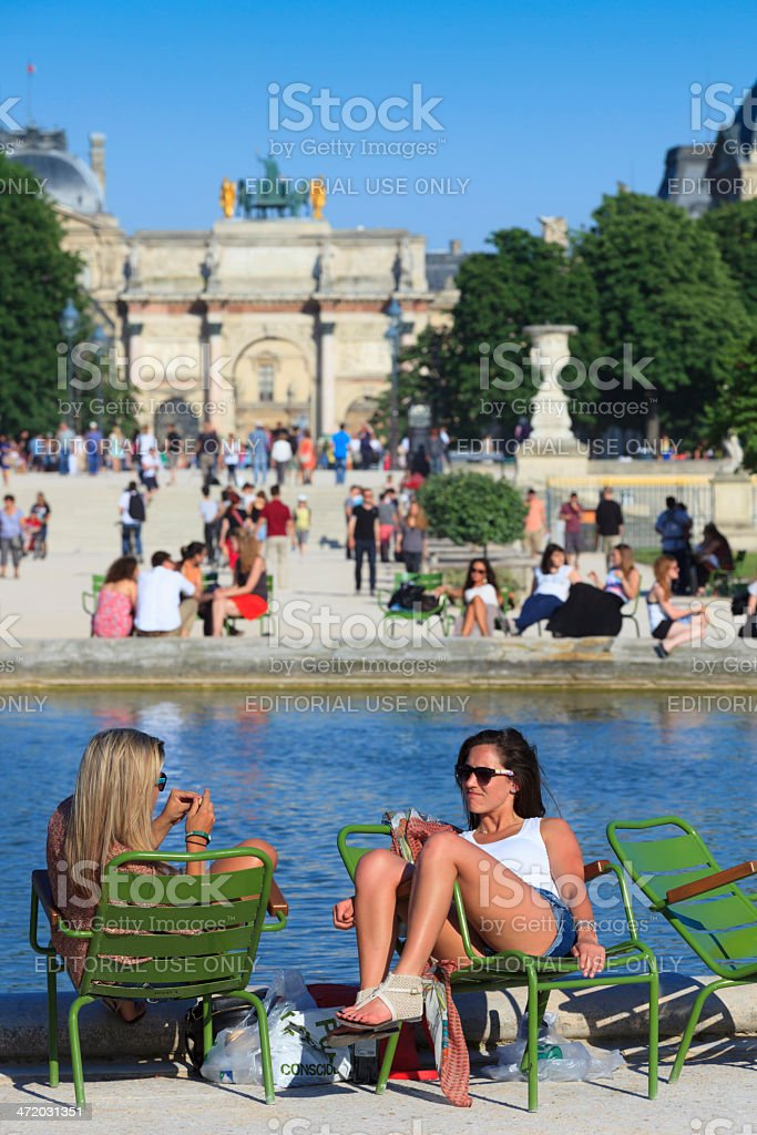 women relaxing at Jardin des Tuileries stock photo