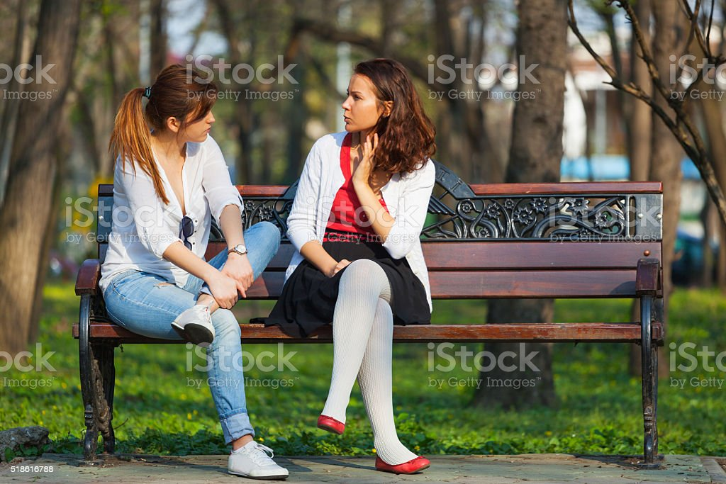 Women relaxing in a park stock photo